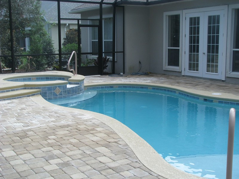 Pool and spa gallery raszl inc palm coast pool and for Custom pool builder
